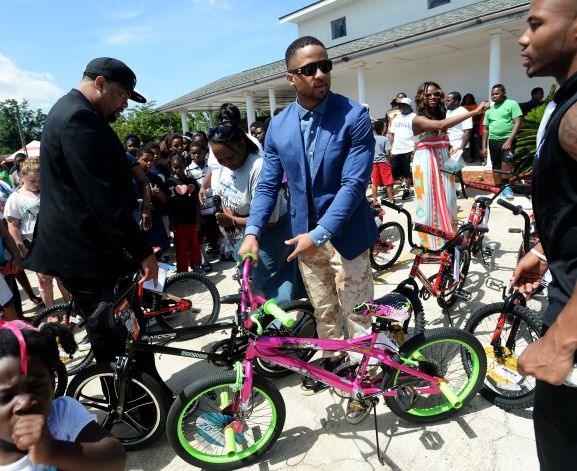 Earl Thomas, III hands on w/ his foundation's bike giveaway in his hometown of Orange, TX.